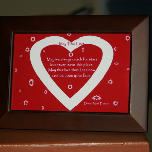 Red Background. White Text. Brown Frame. 6x4 inches.